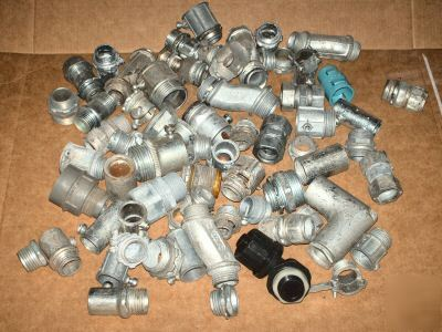 Surplus lot of 50+ assorted electric conduit fittings